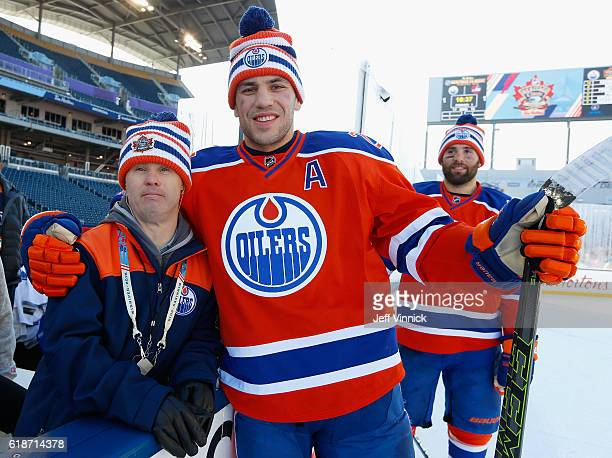 Locker room attendant Joey Moss poses with Milan Lucic of the Edmonton Oilers after practice for the 2016 Tim Hortons NHL Heritage Classic to be...