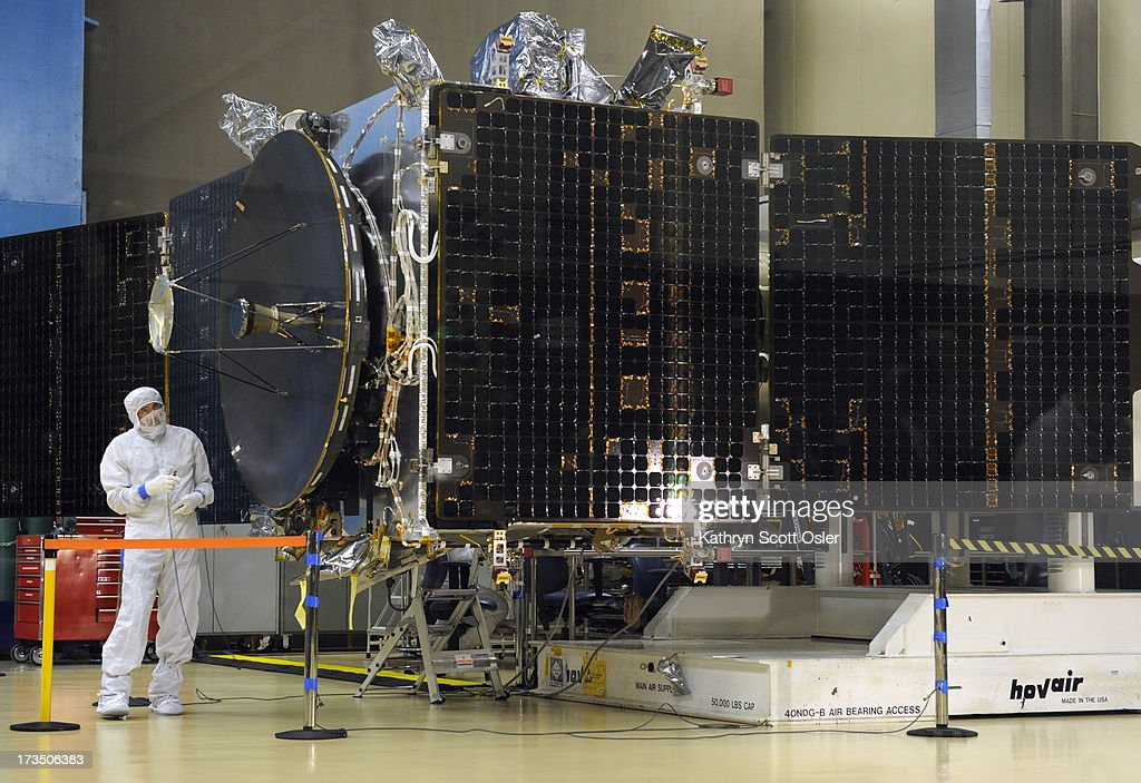 Lockheed Martin engineer Jack Farmerie is preparing to remove the primary high gain antennae from the MAVEN spacecraft for transport The NASA MAVEN...