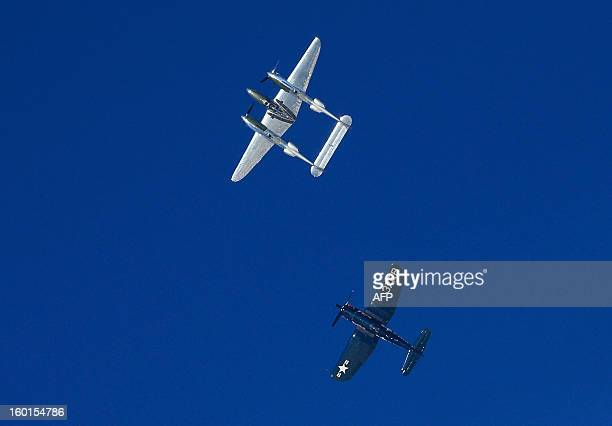 A Lockheed P38 Lightning World War II American fighter aircraft and a Chance Vought F4 U Corsair fly over the Kitzuehel Alps during an exhibition...