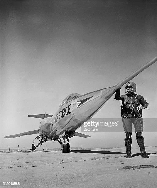Lockheed's chief engineering test pilot Herman R 'Fish' Salmon checks the needlelike nose of Lockheed's supersonic F104A Starfighter before taking...