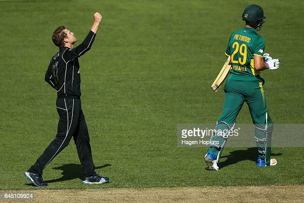 Lockie Ferguson of New Zealand celebrates after taking the wicket of Dwaine Pretorius of South Africa during game three of the One Day International...