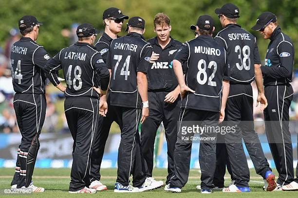 Lockie Ferguson of New Zealand is congratulated by team mates after dismissing Shakib Al Hasan of Bangladesh during the first One Day International...