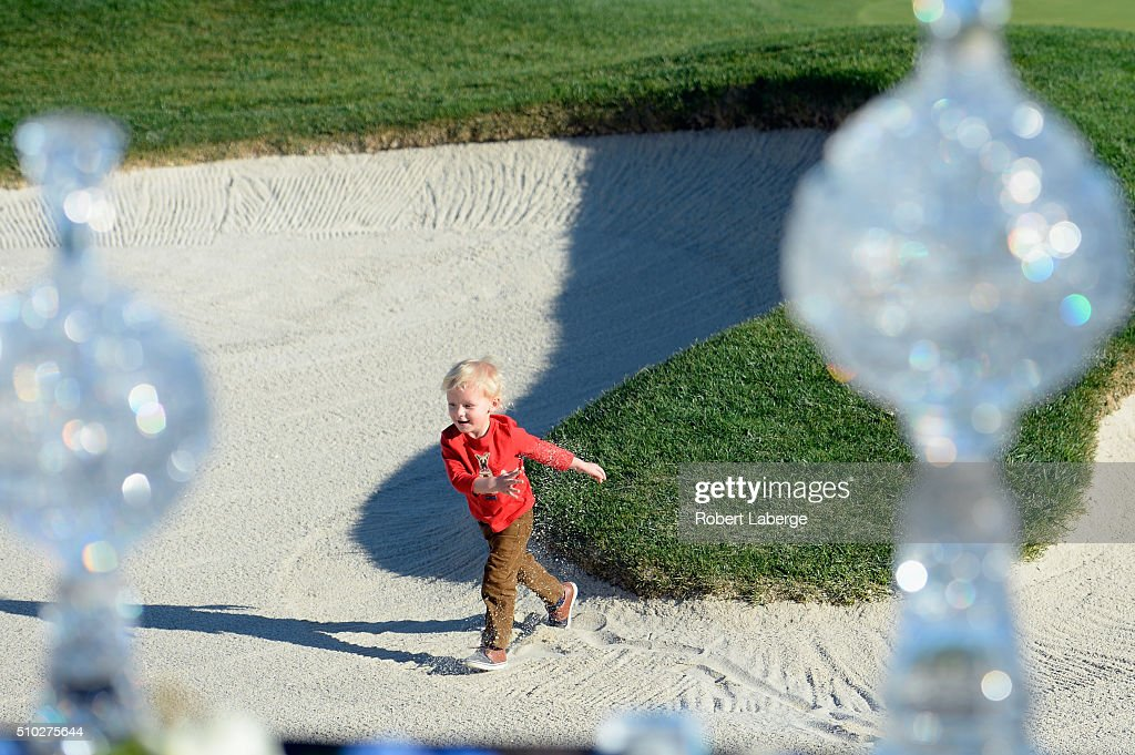 Locklyn Taylor son of Vaughn Taylor celebrates after his father won the ATT Pebble Beach National ProAm at the Pebble Beach Golf Links on February 14...