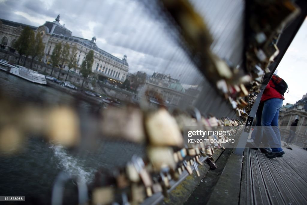 Locks attached by lovers are pictured on the railing of the Solferino bridge on October 27, 2012 in Paris, France.
