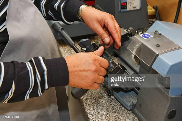 Locksmith at work....making spare key