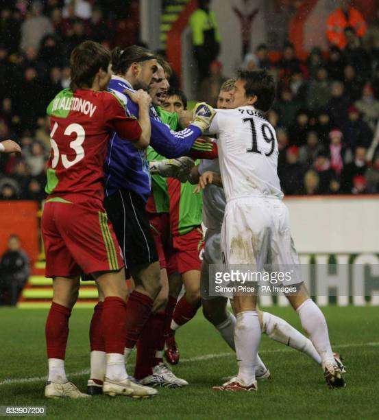 Locomotiv Moscow Lokomotiv goalkeeper Ivan Pelizzoli gets pushy with Aberdeen's Derek Young during the UEFA Cup match at the Pittodrie Stadium...