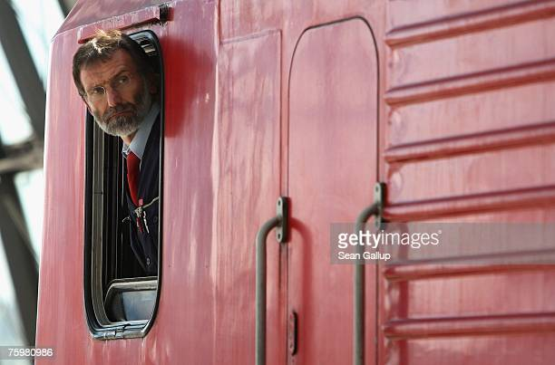 A locomotive engineer of German state rail carrier Deutsche Bahn prepares to drive a train for departure from Hauptbahnhof train station August 6...