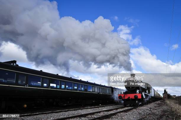 Locomotive GWR Prairie Class number 5542 pulls out of Toddington station taking Cheltenham racegoers to the festival in style aboard the At The Races...