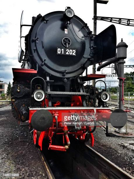 Locomotive Of Steam Train On Track Against Sky