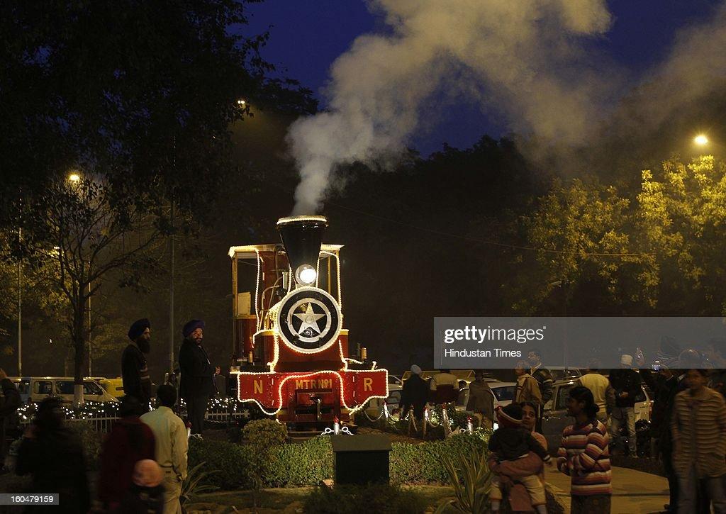 Locomotive small steam Engine on roadside, Baroda House, during Northern railway's Rail fair going on at Baroda house on Febraury 1, 2013 in New Delhi, India.