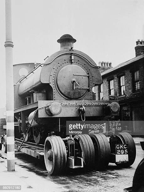 A locomotive train is drawn through the streets of Stretford on the way to the repair shop June 1943