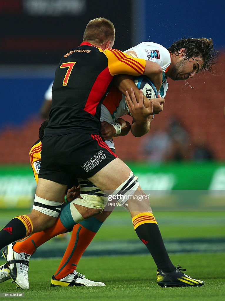 Lodewyk De Jager of the Cheetahs is tackled by Sam Cane of the Chiefs during the round three Super Rugby match between the Chiefs and the Cheetahs at Waikato Stadium on March 2, 2013 in Hamilton, New Zealand.