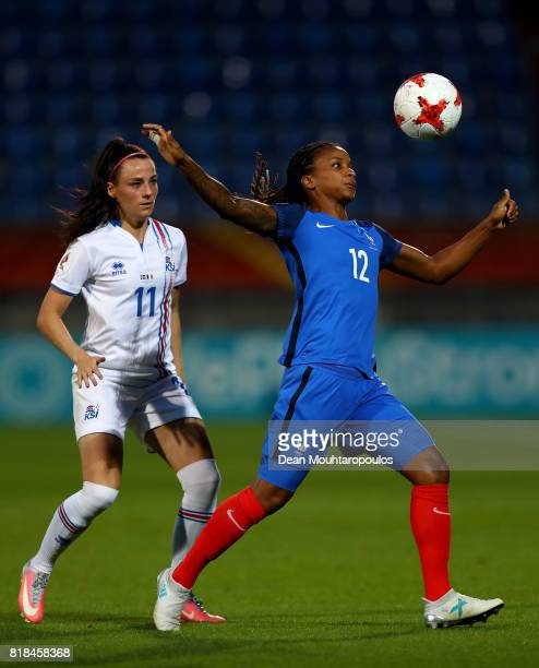Élodie Thomis of France and Hallbera Gísladóttir of Iceland compete for the ball during the Group C match between France and Iceland during the UEFA...