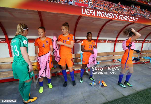 Loes Geurts Mandy Van Den Berg Kelly Zeeman and Lineth Beerensteyn of Netherlands Women get ready as they sit on the bench before the UEFA Women's...