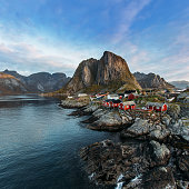 Lofoten islands is an archipelago in the county of Nordland, Norway. Distinctive scenery with dramatic mountains and peaks, open sea and sheltered bays and red fishing huts, called rorbu.