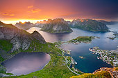 View from Reinebringen at Lofoten Islands, located in Norway, during summer sunset.
