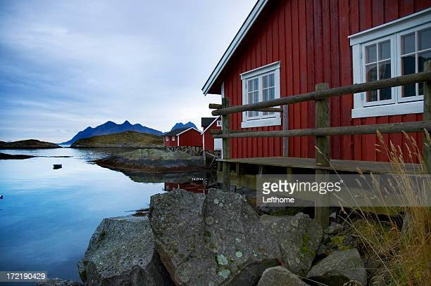 Lofoten, Norway. Traditional red fishing huts on a fjord