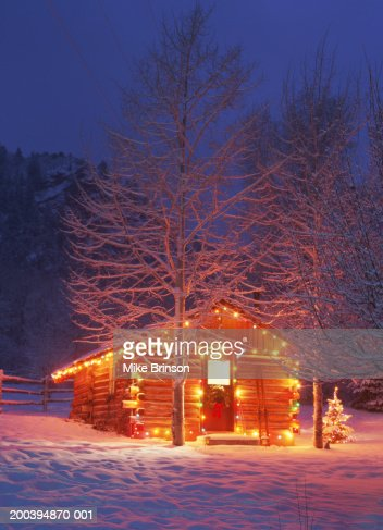 Log Cabin Exterior Decorated With Christmas Lights Winter Night