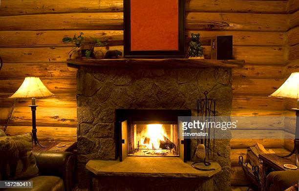 Chalet stock photos and pictures getty images for Cabin fireplace pictures