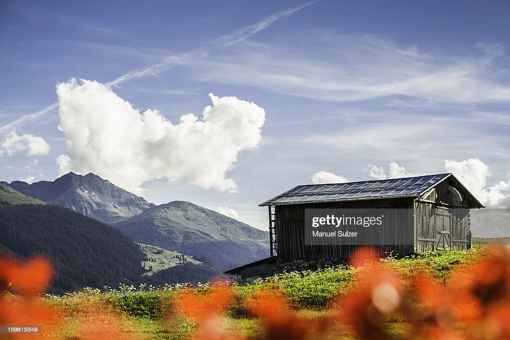 Log cabin in rural landscape : Stock Photo