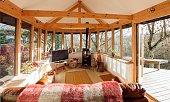 Interior shot of a log cabin living room.