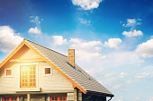 log lodge with gray tile roof against blue sky