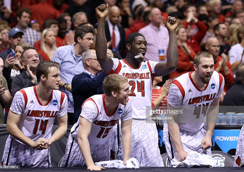 Logan Baumann #14, Tim Henderson #15, Montrezl Harrell #24 and Stephan Van Treese #44 of the Louisville Cardinals celebrate on the bench against the Duke Blue Devils during the Midwest Regional Final round of the 2013 NCAA Men's Basketball Tournament at Lucas Oil Stadium on March 31, 2013 in Indianapolis, Indiana.