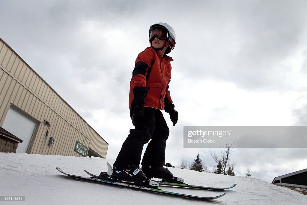 Logan Boynton, 8, pauses before heading down Exodus run at Loon Mountain Resort in Lincoln, New Hampshire on November 24, 2012.