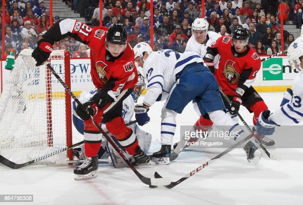Logan Brown and Alexandre Burrows of the Ottawa Senators control the puck at the net against Nikita Zaitsev and Jake Gardiner of the Toronto Maple...