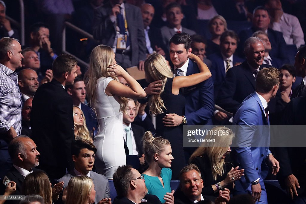 Logan Brown celebrates with family after being selected 11th overall by the Ottawa Senators during round one of the 2016 NHL Draft on June 24, 2016 in Buffalo, New York.