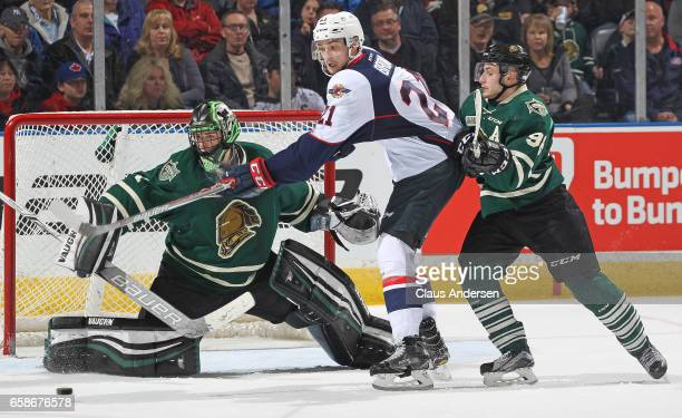 Logan Brown of the Windsor Spitfires looks to tip a shot in front of Tyler Parsons of the London Knights during Game Two of the OHL Western...