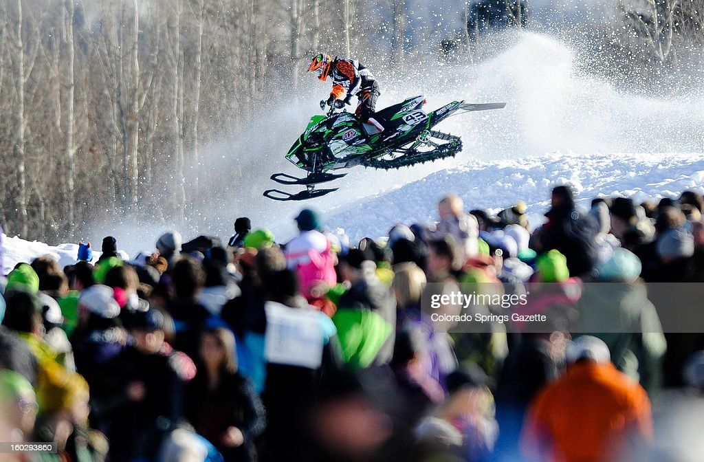 Logan Christian drives through a cloud of snow as he races around the track in the SnoCross finals during the ESPN X Games in Aspen, Colorado, Sunday, January 27, 2013.