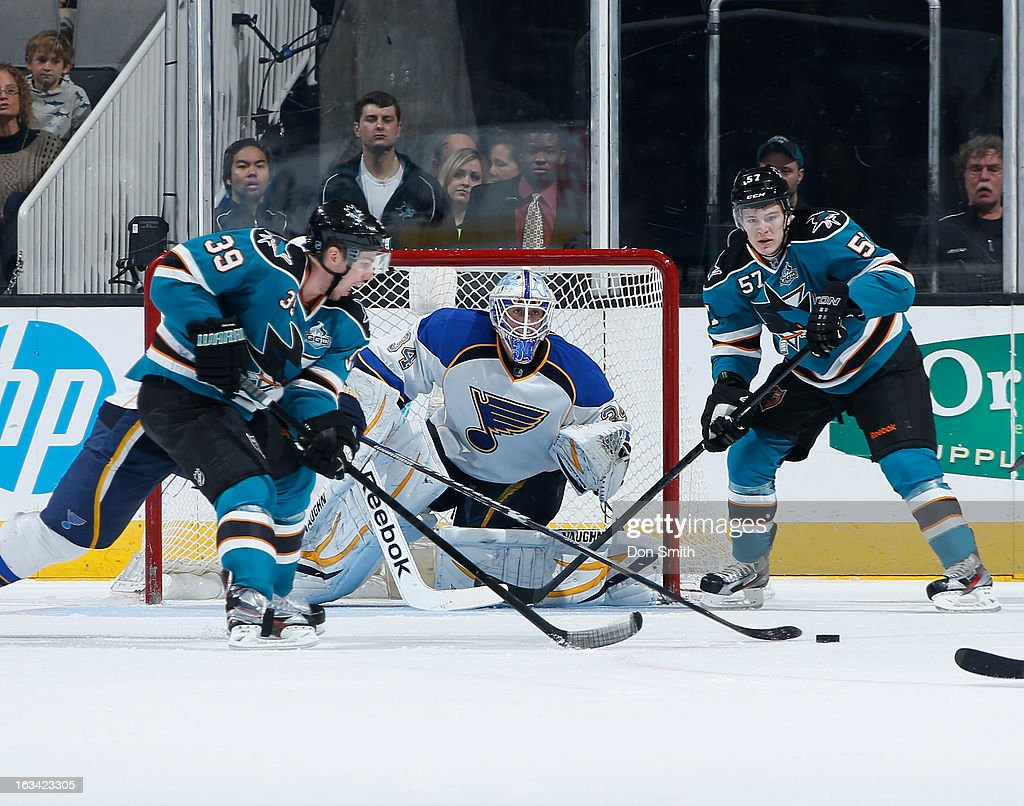 Logan Couture #39 and Tommy Wingels #57 of the San Jose Sharks surround the net against Jake Allen #34 of the St. Louis Blues during an NHL game on March 9, 2013 at HP Pavilion in San Jose, California.