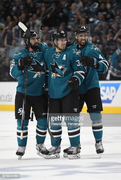 Logan Couture David Schlemko and Brenden Dillon of the San Jose Sharks celebrate after Couture scored a goal against the Edmonton Oilers during the...