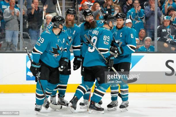 Logan Couture Joe Thornton Brent Burns Mikkel Boedker and Joe Pavelski of the San Jose Sharks celebrate Couture's third period goal during a NHL game...