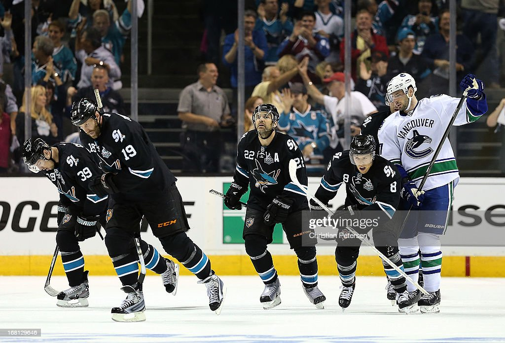 Logan Couture #39, Joe Thornton #19, Dan Boyle #22, and Joe Pavelski #8 of the San Jose Sharks skate back to the bench after Joe Pavelski scored a first period power play goal against the Vancouver Canucks in Game Three of the Western Conference Quarterfinals during the 2013 NHL Stanley Cup Playoffs at HP Pavilion on May 5, 2013 in San Jose, California.