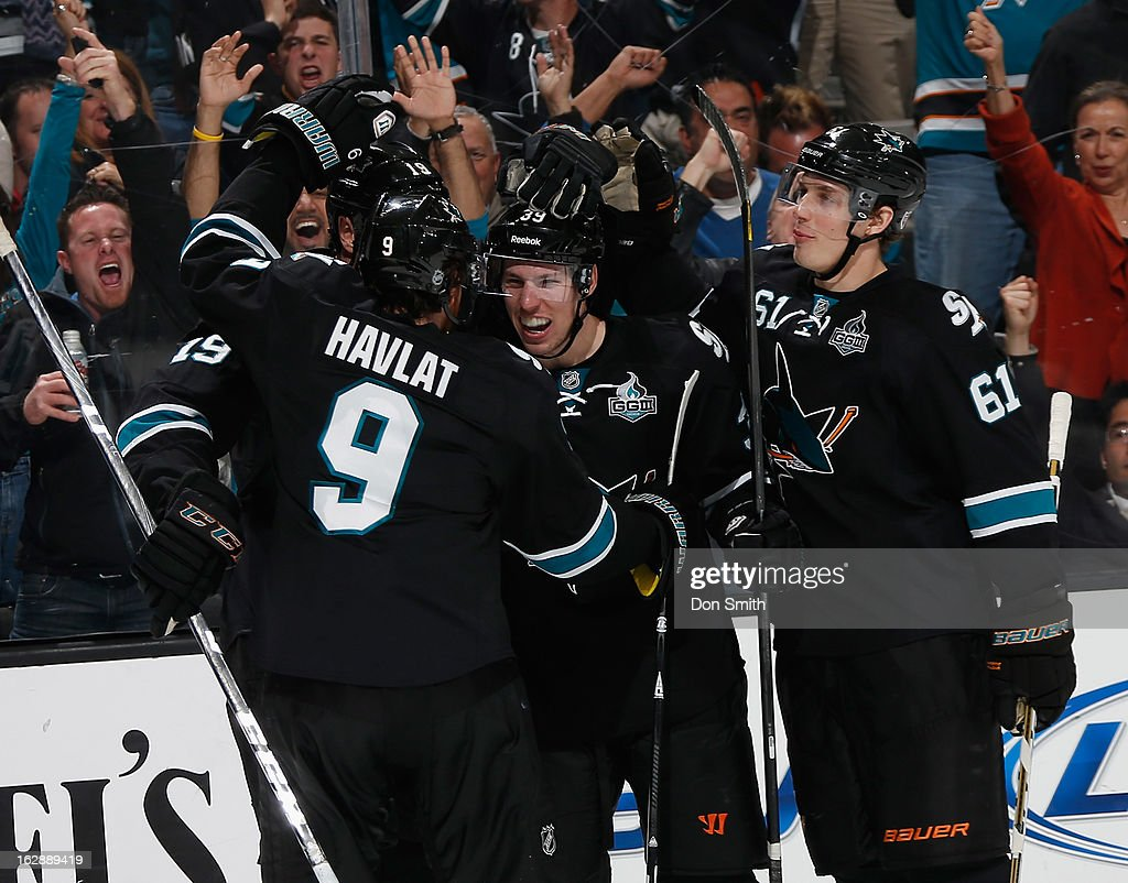 <a gi-track='captionPersonalityLinkClicked' href=/galleries/search?phrase=Logan+Couture&family=editorial&specificpeople=809700 ng-click='$event.stopPropagation()'>Logan Couture</a> #39, Justin Braun #61 and <a gi-track='captionPersonalityLinkClicked' href=/galleries/search?phrase=Martin+Havlat&family=editorial&specificpeople=202654 ng-click='$event.stopPropagation()'>Martin Havlat</a> #9 of the San Jose Sharks celebrate Couture's goal against the Detroit Red Wings during an NHL game on February 28, 2013 at HP Pavilion in San Jose, California.