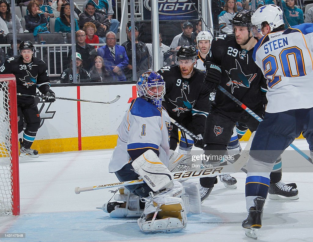 Logan Couture #39, Martin Havlat #9 and Ryane Clowe #29 of the San Jose Sharks watch as Joe Thornton's goal enters the net against Billy Elliott #1 and Alexander Steen #20 of the St. Louis Blues in Game Four of the Western Conference Quarterfinals during the 2012 NHL Stanley Cup Playoffs at HP Pavilion on April 19, 2012 in San Jose, California.