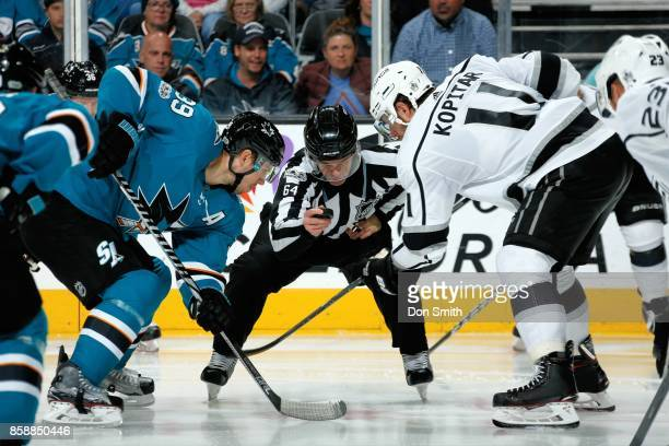 Logan Couture of the San Jose Sharks and Anze Kopitar of the Los Angeles Kings face off during a NHL game at SAP Center at San Jose on October 7 2017...