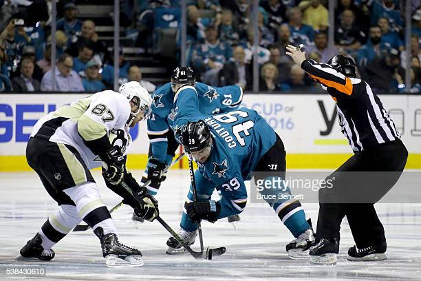 Logan Couture of the San Jose Sharks and Sidney Crosby of the Pittsburgh Penguins take the opening faceoff in Game Four of the 2016 NHL Stanley Cup...