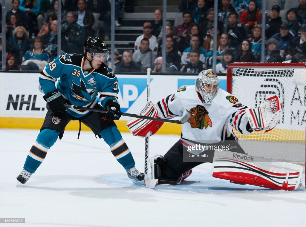 <a gi-track='captionPersonalityLinkClicked' href=/galleries/search?phrase=Logan+Couture&family=editorial&specificpeople=809700 ng-click='$event.stopPropagation()'>Logan Couture</a> #39 of the San Jose Sharks attempts to score against <a gi-track='captionPersonalityLinkClicked' href=/galleries/search?phrase=Corey+Crawford&family=editorial&specificpeople=818935 ng-click='$event.stopPropagation()'>Corey Crawford</a> #50 of the Chicago Blackhawks during an NHL game on February 5, 2013 at HP Pavilion in San Jose, California.