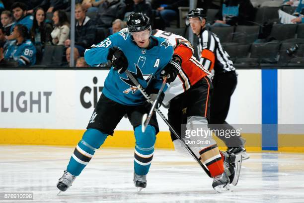Logan Couture of the San Jose Sharks battles against Corey Perry of the Anaheim Ducks at SAP Center on November 20 2017 in San Jose California