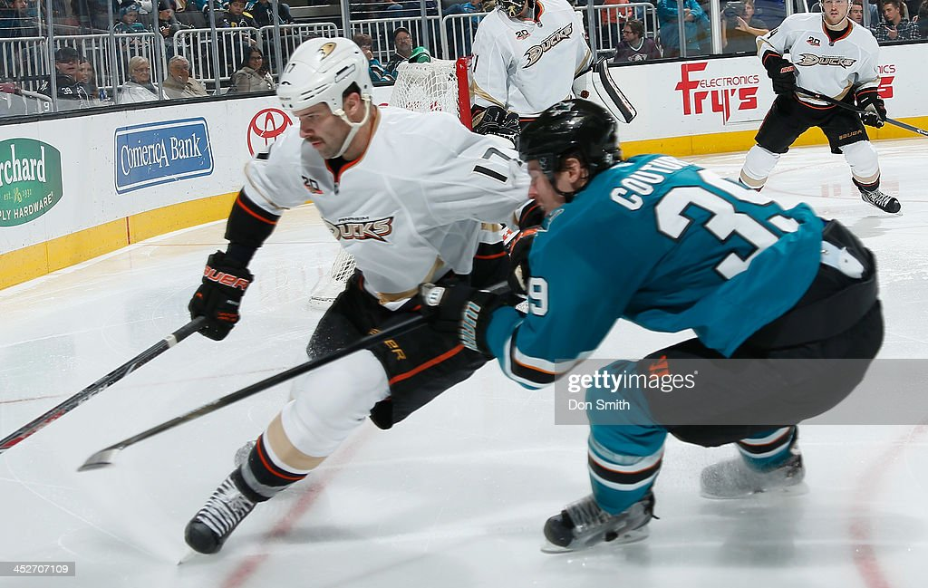<a gi-track='captionPersonalityLinkClicked' href=/galleries/search?phrase=Logan+Couture&family=editorial&specificpeople=809700 ng-click='$event.stopPropagation()'>Logan Couture</a> #39 of the San Jose Sharks battles for the puck against <a gi-track='captionPersonalityLinkClicked' href=/galleries/search?phrase=Dustin+Penner&family=editorial&specificpeople=589919 ng-click='$event.stopPropagation()'>Dustin Penner</a> #17 of the Anaheim Ducks during an NHL game on November 30, 2013 at SAP Center in San Jose, California.
