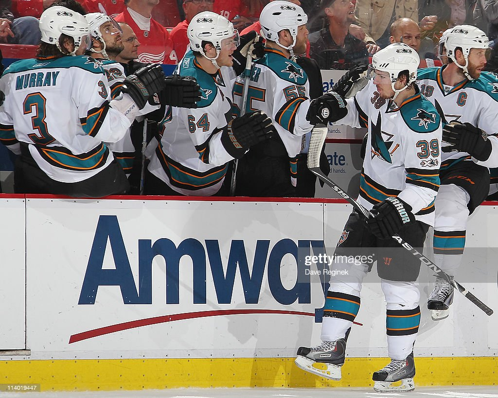 Logan Couture #39 of the San Jose Sharks celebrates his goal with teammates during Game Six of the Western Conference Semifinals of the 2011 NHL Stanley Cup Playoffs against the Detroit Red Wings at Joe Louis Arena on May 10, 2011 in Detroit, Michigan.