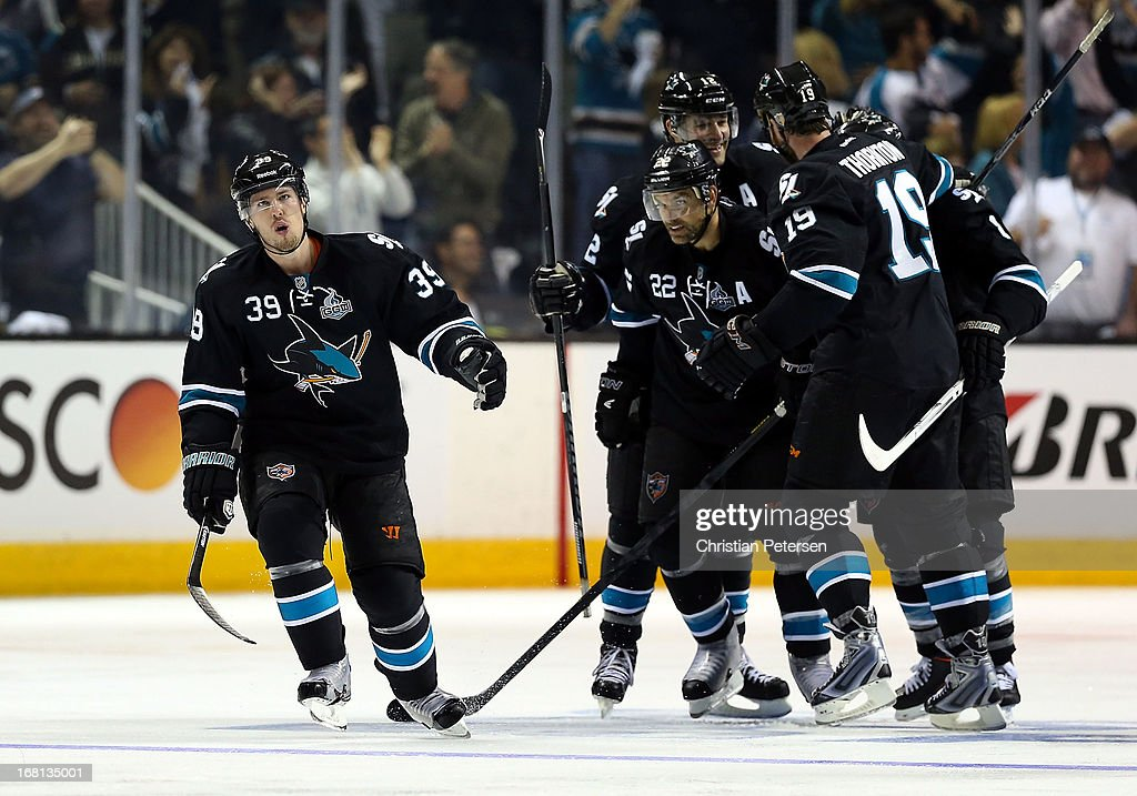 Logan Couture #39 of the San Jose Sharks celebrates with teamamtes Dan Boyle #22, Patrick Marleau #12, Joe Thornton #19 and Joe Pavelski #8 after scoring a third period power play goal against the Vancouver Canucks in Game Three of the Western Conference Quarterfinals during the 2013 NHL Stanley Cup Playoffs at HP Pavilion on May 5, 2013 in San Jose, California. The Sharks defeated the Canucks 5-2.