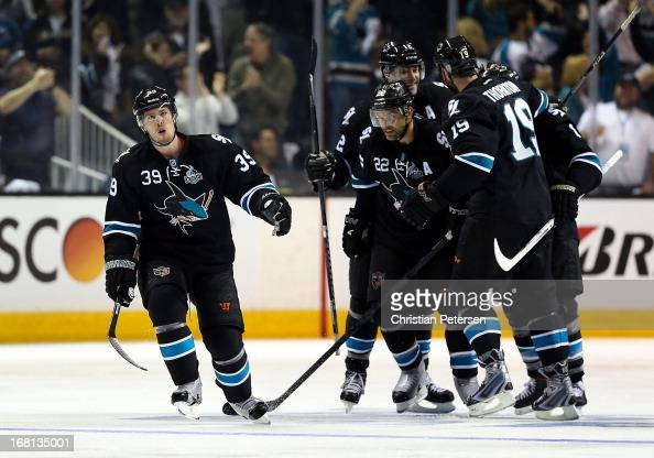 Logan Couture of the San Jose Sharks celebrates with teamamtes Dan Boyle Patrick Marleau Joe Thornton and Joe Pavelski after scoring a third period...