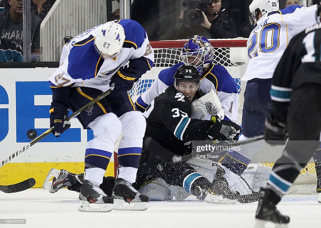 <a gi-track='captionPersonalityLinkClicked' href=/galleries/search?phrase=Logan+Couture&family=editorial&specificpeople=809700 ng-click='$event.stopPropagation()'>Logan Couture</a> #39 of the San Jose Sharks collides with <a gi-track='captionPersonalityLinkClicked' href=/galleries/search?phrase=Brian+Elliott&family=editorial&specificpeople=687032 ng-click='$event.stopPropagation()'>Brian Elliott</a> #1 of the St. Louis Blues in Game Four of the Western Conference Quarterfinals during the 2012 NHL Stanley Cup Playoffs at HP Pavilion on April 19, 2012 in San Jose, California.