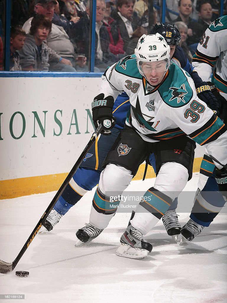 Logan Couture of the San Jose Sharks contras the puck in front of Scott Nichol of the St Louis Blues in an NHL game on February 19 2013 at Scottrade...