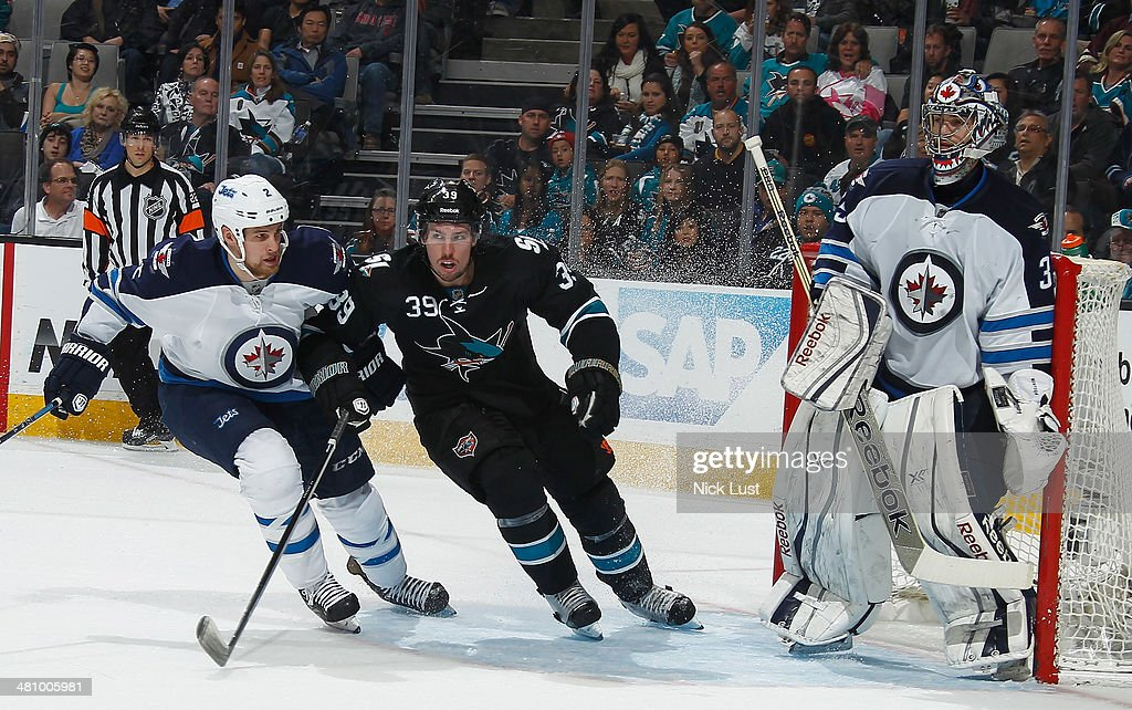 <a gi-track='captionPersonalityLinkClicked' href=/galleries/search?phrase=Logan+Couture&family=editorial&specificpeople=809700 ng-click='$event.stopPropagation()'>Logan Couture</a> #39 of the San Jose Sharks crowds the net against <a gi-track='captionPersonalityLinkClicked' href=/galleries/search?phrase=Adam+Pardy&family=editorial&specificpeople=2221762 ng-click='$event.stopPropagation()'>Adam Pardy</a> #2 and <a gi-track='captionPersonalityLinkClicked' href=/galleries/search?phrase=Al+Montoya&family=editorial&specificpeople=213916 ng-click='$event.stopPropagation()'>Al Montoya</a> #35 of the Winnipeg Jets during an NHL game on March 27, 2014 at SAP Center in San Jose, California.