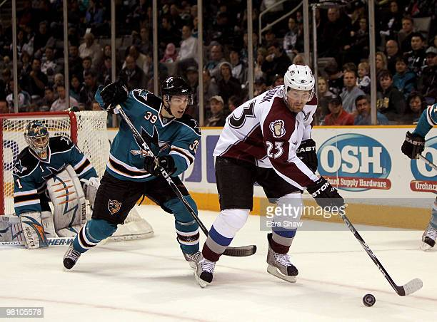Logan Couture of the San Jose Sharks defends Milan Hejduk of the Colorado Avalanche at HP Pavilion on March 28 2010 in San Jose California
